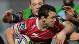 Aaron Warren of Scarlets is tackled during the Heineken Cup Pool Four match against and Harlequins