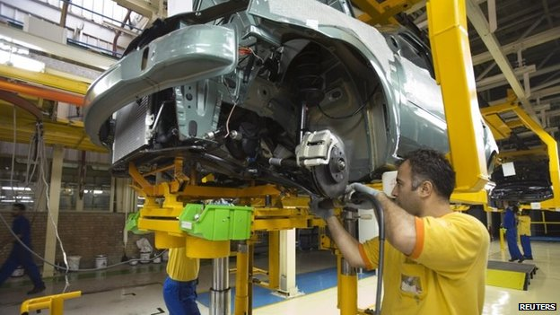 Men assembly a Tondar car at a joint venture assembly plant between Iran's Khodro and France's Renault