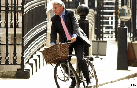 Andrew Mitchell riding a bicycle