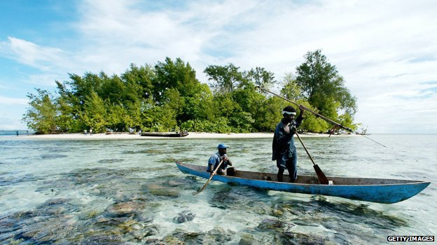 Fishermen paddle off Kennedy Island in the Solomon Islands