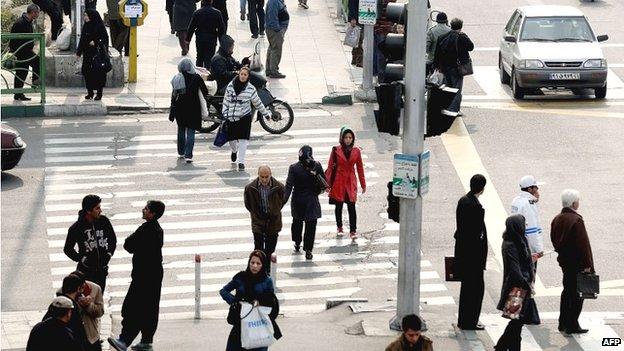 Iranians crossing a Tehran street