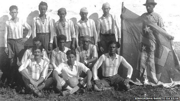 On a farm deep in the countryside 100 miles (160km) west from Sao Paulo, a football team has lined up for a commemorative photograph. What makes the image extraordinary is the symbol on the team's flag - a swastika.