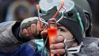 A pro-European integration protester uses a slingshot during clashes with police in Kiev January 20, 2014