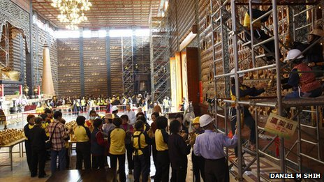Volunteers transfer Buddha statues at the Fo Guang Shan temple in Kaohsiung