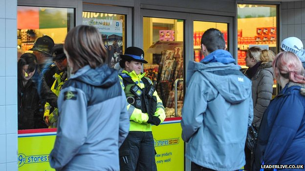 Police officers at the 99p Stores in Wrexham