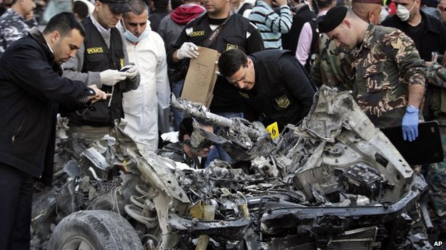 A destroyed car at the scene of a bomb blast in southern Beirut, 21 January 2014