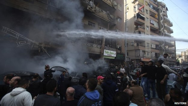 Firefighters tackle a blaze caused by a bomb attack in southern Beirut, 21 January 2014