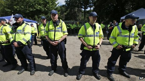 Police officers guard the entrance to the drilling site in Balcombe