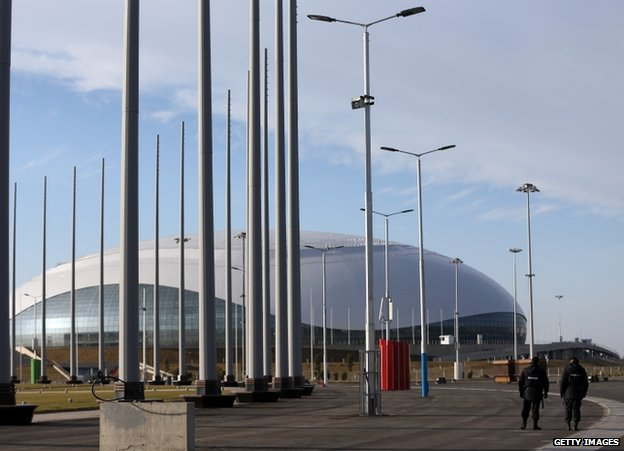 Security guards walk near the Olympic Park in Adler, Russia, 9 January