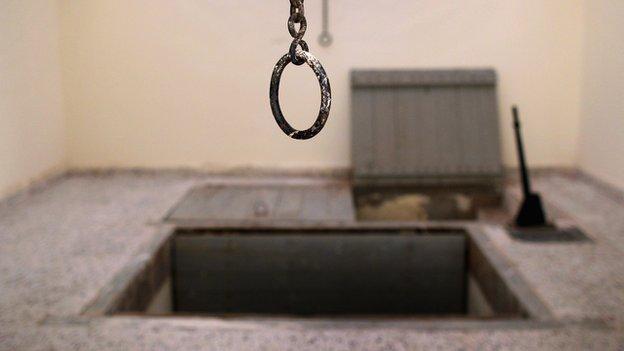 A hangman's gallows sits idle
