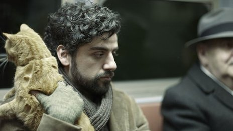 Oscar Isaac and runaway cat in Inside Llewyn Davis