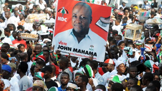 National Democratic Congress supporters carry a picture of John Dramani Mahama after he won elections in December 2012