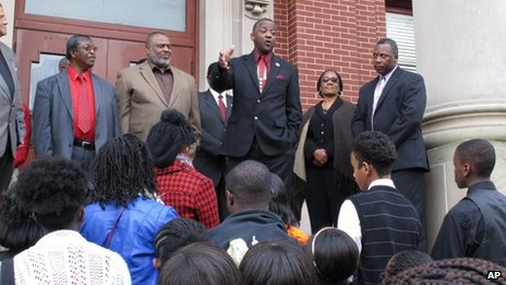 George Frierson, centre, tells a crowd he won't stop fighting to exonerate George Stinney, at a rally calling for justice in Manning, South Carolina 10 December 2013