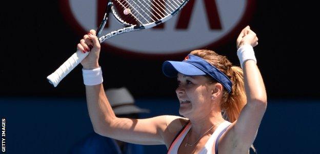 Agnieszka Radwanska celebrates beating Victoria Azarenka