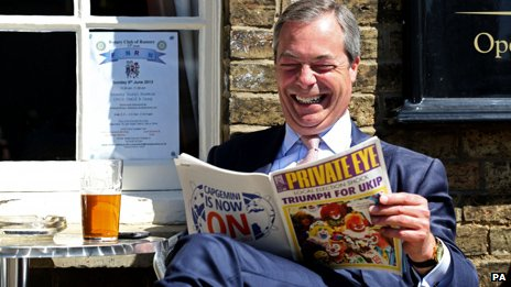 "Nigel Farage outside a pub, reading a copy of Private Eye with the headline ""Victory for UKIP"""