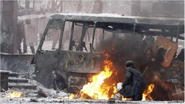 Protesters by a burning bus in Kiev, Ukraine (22 Jan 2014)