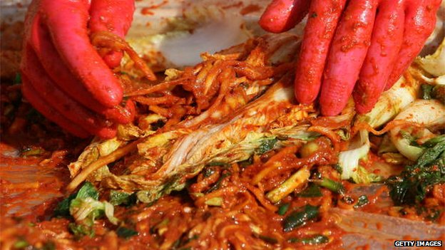 South Korean women make kimchi, a traditional pungent vegetable dish, in Seoul, South Korea, 9 November 2009