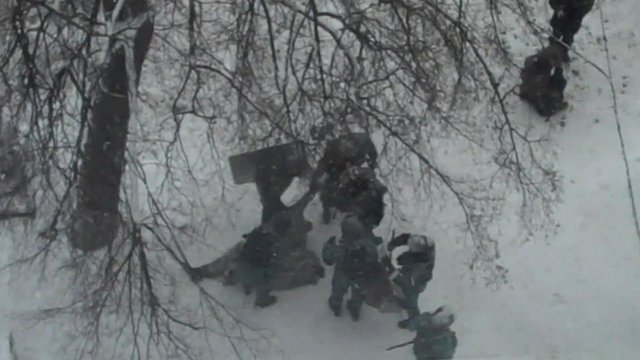 Police drag body away