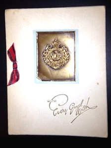Card with metal insignia of Royal Engineers on the front