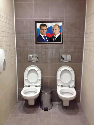 Putin and Medvedev above the double toilets