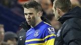 Everton assistant manager Graeme Jones speaks with Seamus Coleman after he is brought off
