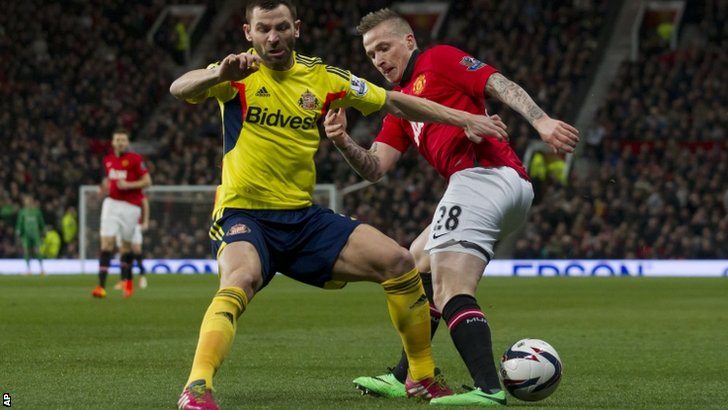 Sunderland's Phillip Bardsley (left) and Manchester United's Alexander Buttner