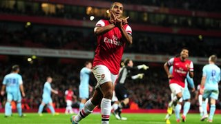 Theo Walcott celebrates scoring Arsenal's final goal in the 6-1 League Cup win over Coventry City at the Emirates, September 2012
