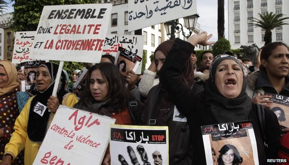 Women from various regions of Morocco hold placards in the capital Rabat to protest against violence towards women (24 November 2013)
