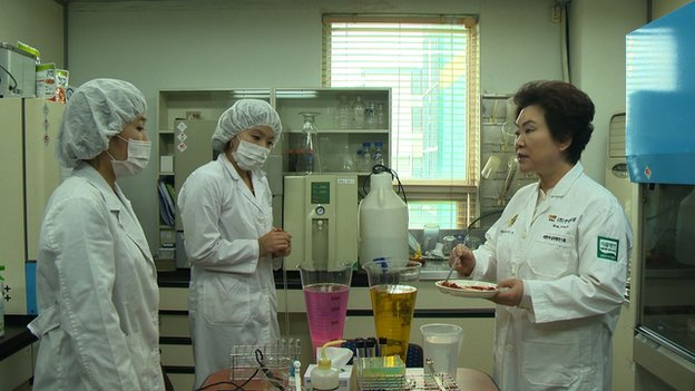Kim Soon-ja (right) and two colleagues in her laboratory