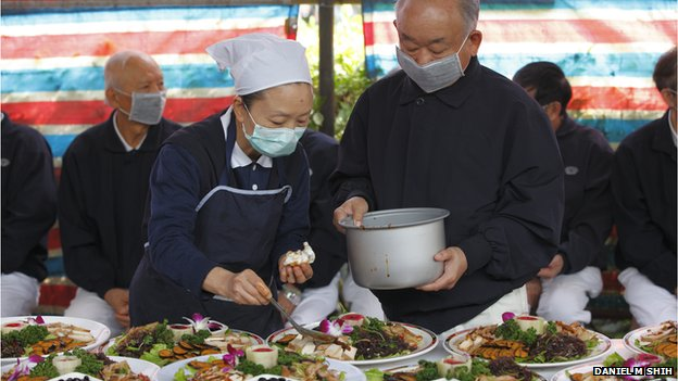 Volunteers serve food at a Tzu Chi event on 18 January 2014