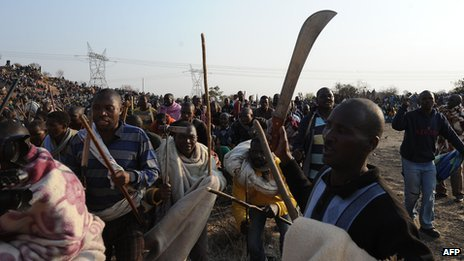 Strikers with weapons in Marikana, 2012