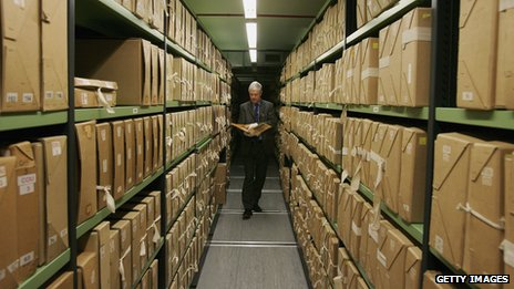 An archivist peruses documents