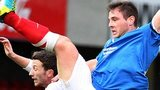 Jamie Mulgrew battles with William Faulkner during the Premiership clash between Linfield and Ards in November
