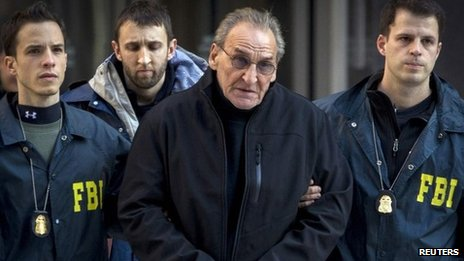 Vincent Asaro is escorted by FBI agents from their Manhattan offices in New York 23 January 2014