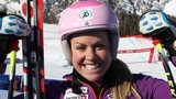Britain's Chemmy Alcott smiles for a photograph at the finish area after completing an alpine ski, World Cup women's downhill training