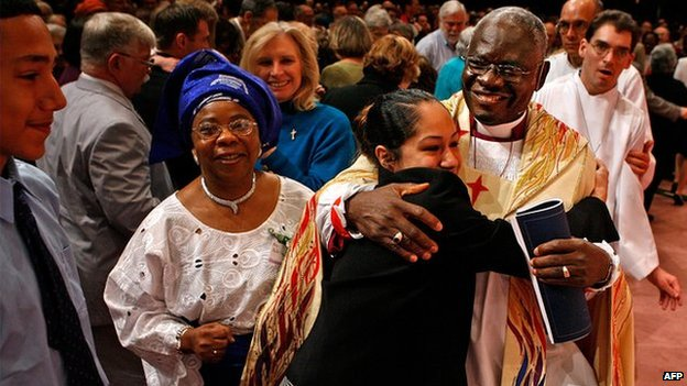 Nigeria's Peter Akinola (R) is embraced by congregants at a chapel in the US on 5 May 2007