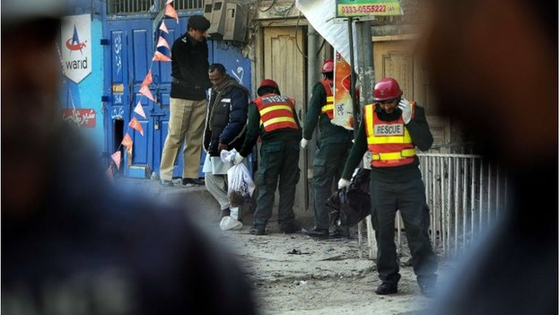 Pakistani volunteers search the site of a suicide bomb attack in Rawalpindi on January 20, 2014. A Taliban suicide bomber killed at least nine people in a market close to Pakistan's military headquarters, a day after one of the deadliest attacks on security forces in recent years.