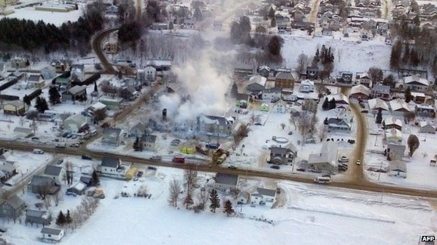 This aerial photo released courtesy of Surete du Quebec shows the remains of a massive fire at a Quebec residence for the elderly 23 January 2014