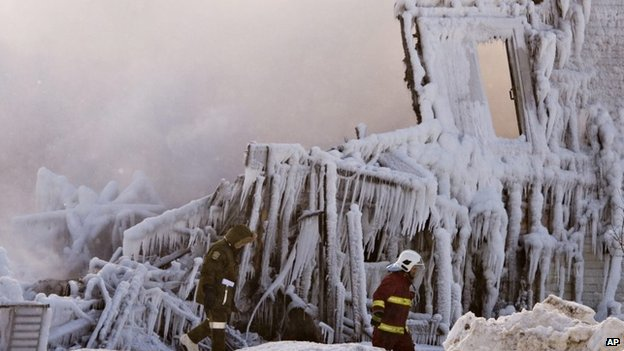 Firefighters work at the scene of a seniors residence fire on Thursday,  L'Isle-Verte, Quebec 23 January 2014