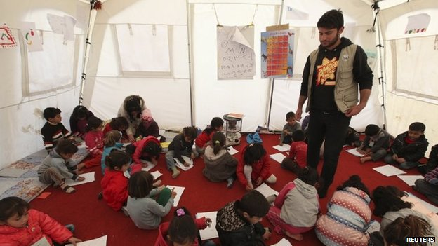 Children attend a class at Quru Gusik refugee camp on the outskirts of Irbil, in Iraq