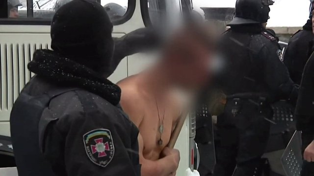 Protesters stripped and beaten in -10c