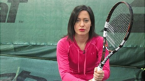 Reporter LJ Rich with the Babolat computer racquet