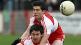 Derry's Dermot McBride challenges Tyrone's Matthew Donnelly in the McKenna Cup semi-final