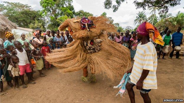 Traditional dance in straw costume in  in Mokpangumba