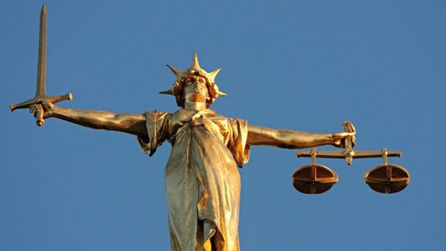 The figure of Lady Justice,