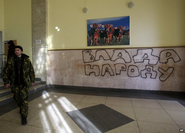 A protester inside the agricultural policy ministry in Kiev, 24 January