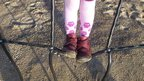 Girl standing on a climbing frame