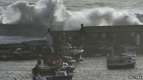 Waves crash over the Cobb at Lyme Regis