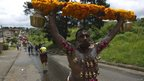 "A Hindu devotee with pierced cheeks and chest carries a ""kavady"" in Chatsworth, Durban, on 19 January 2014"