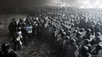 Riot police officers gather as they clash with protestors in the centre of Kiev